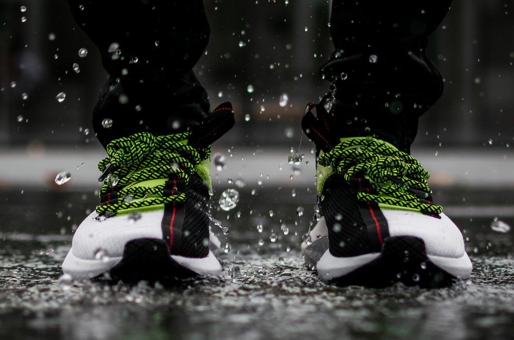 Photo of sneakers in rain with water droplets bounce off
